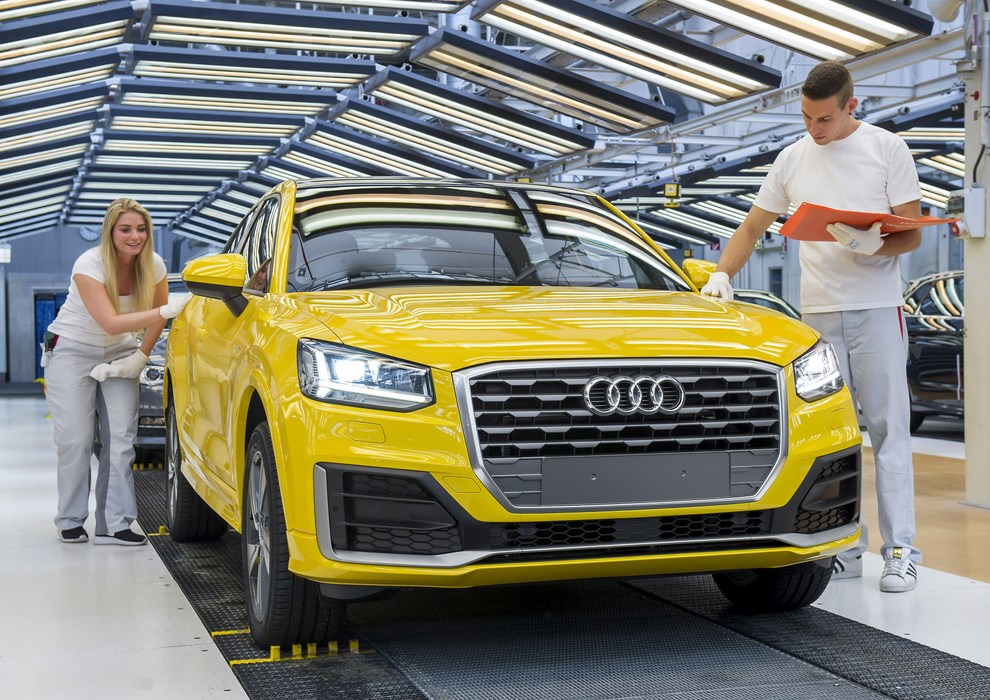 Start of series production of Audi Q2 at main plant in Ingolstadt – employees applies their trained eyes to inspect an Audi Q2 before it leaves the assembly line.