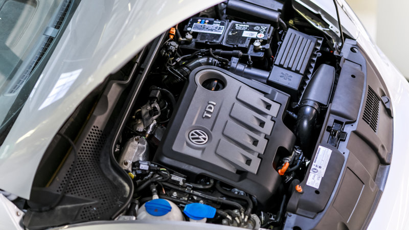 WOLFSBURG, GERMANY - AUGUST 04: A TDI Diesel vehicle engine pictured under a bonnet at dual training workshop or Duale Ausbildungswerkstatt at Volkswagen AG plant on August 04, 2017 in Wolfsburg, Germany. (Photo by Michael Gottschalk/Photothek via Getty Images)