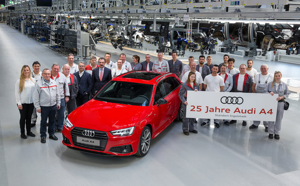 Jubilee at the Four Rings: 25 years ago the first Audi A4 drove off the assembly line at the plant in Ingolstadt. The employees and management are proud of the most successful Audi model of all time.  Picture: Employees from all production departments and from quality assurance with Plant Director Albert Mayer (front, fifth from the left) and Chairman of Audi's General Works Council Peter Mosch (front, fourth from the left).